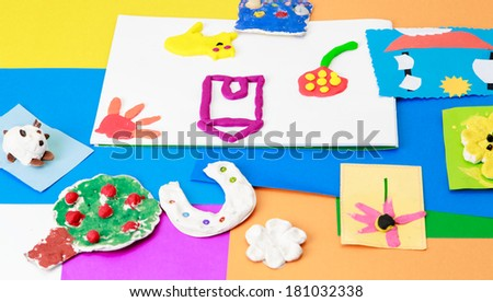 baby crafts from play dough and paper, early eduction concept - stock photo