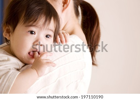 Baby Crying While Putting A Finger In The Mouth - stock photo