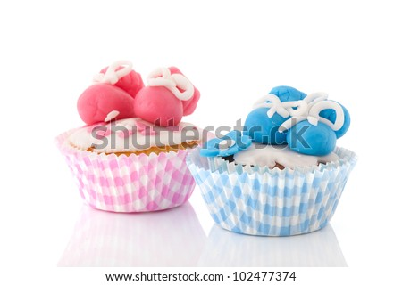Baby cupcakes with shoes in pink and blue