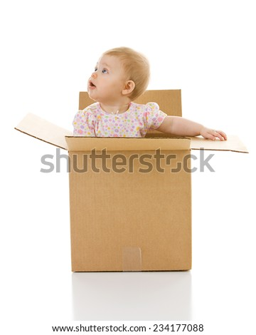 Baby: Curious Kid Inside Cardboard Box - stock photo