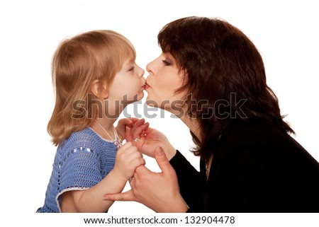 Baby daughter and mother kissing. Side view.  Isolated on white background - stock photo