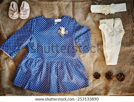 Baby dotted dress. Eco clothes. baby girl clothes. Baby girl clothes composition.  - stock photo