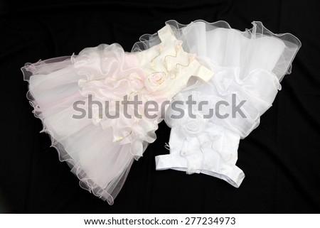 Baby dress white. Closeup photo
