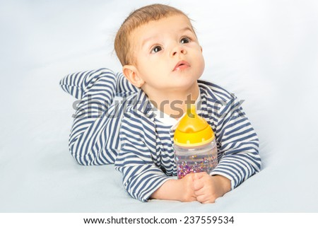 baby  drinking milk from bottle - stock photo