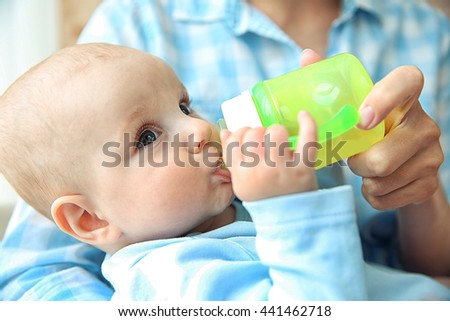Baby drinking water - stock photo