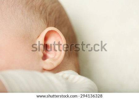 Baby ear, closeup - stock photo