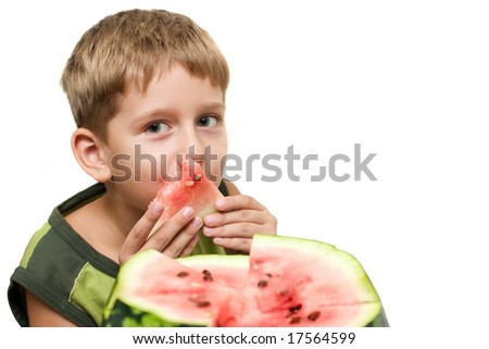 Baby eat of lick watermelon