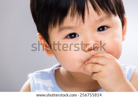 Baby eat the cookie - stock photo