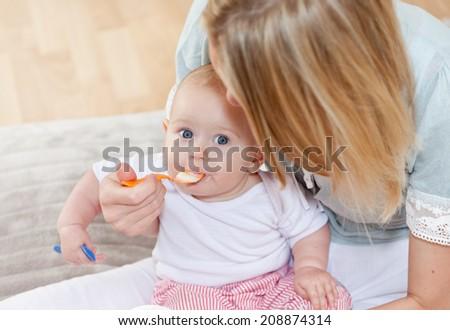 baby eating - stock photo