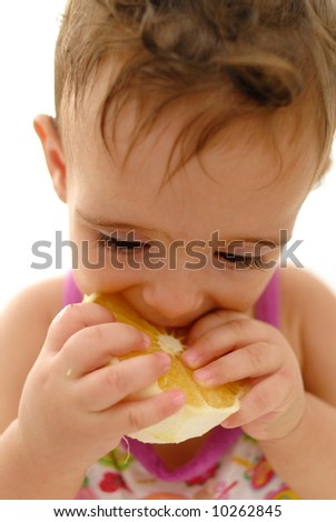 Baby eating an Sweet Orange Fruit .