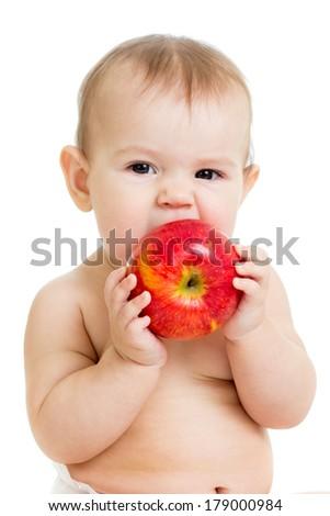 Baby eating apple, isolated on white - stock photo