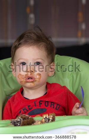 baby eating cake - stock photo