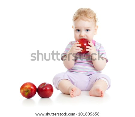 Baby eating healthy food isolated - stock photo