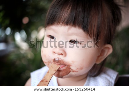 baby eating ice cream - stock photo