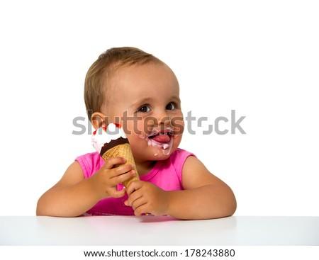 baby eating ice cream isolated on white - stock photo