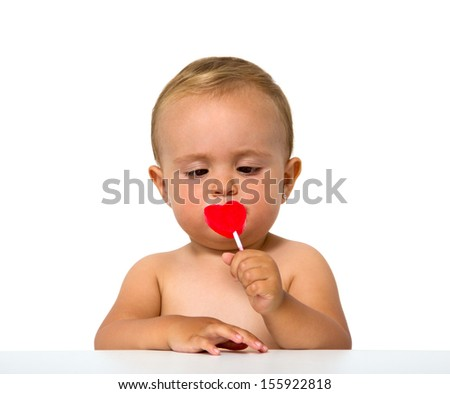 baby eating lollipop isolated on white - stock photo