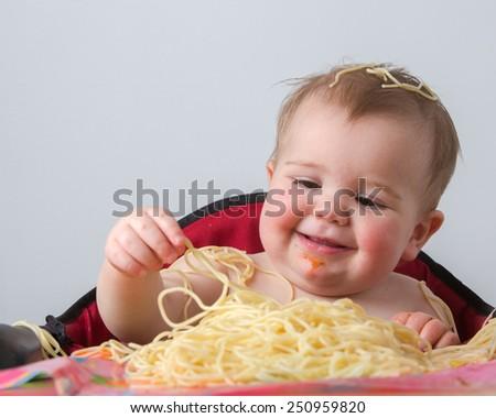 Baby Eating Pasta - stock photo