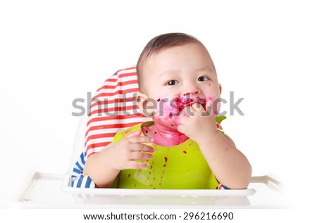 baby eating red dragon fruit - stock photo