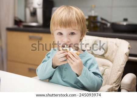 baby eats  - stock photo