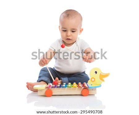 Baby enjoy in rhythm music isolated - stock photo