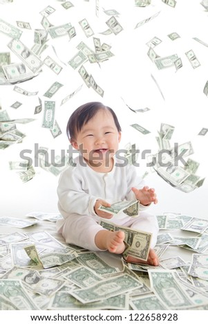 baby excited smile with money rain in the air isolated on a white background, concept for business, asian girl baby child - stock photo