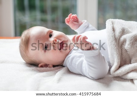 Baby face Portrait of cute 6 months baby girl - stock photo