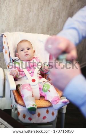 baby feeding process - stock photo