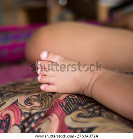 baby feet facing - stock photo