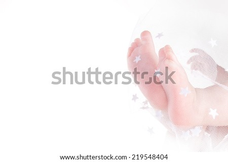 Baby feet in the fabric on a white background