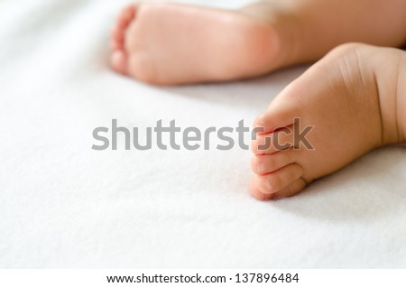 Baby Feet on White - stock photo