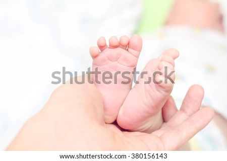 baby feet. very small children's feet. little legs.care. heed. mather arm