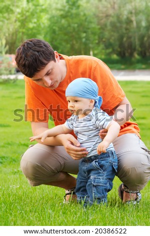 baby first steps - stock photo