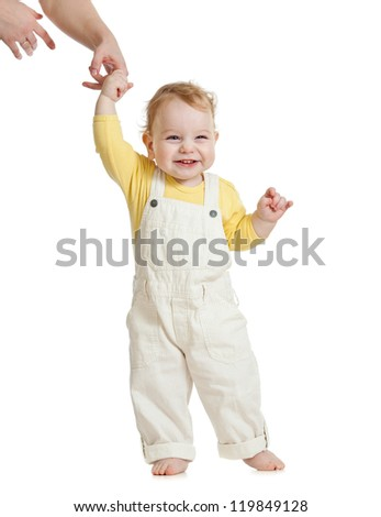 baby first steps with parent help - stock photo
