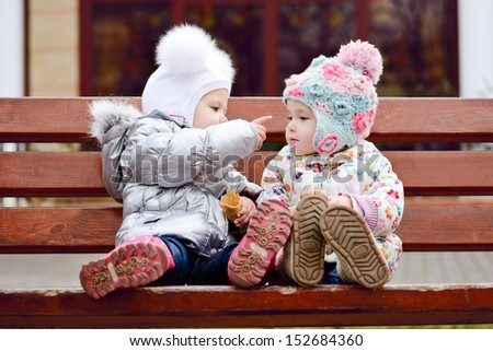 baby friends sitting on the bench