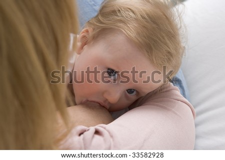 Baby gets breastfeeding