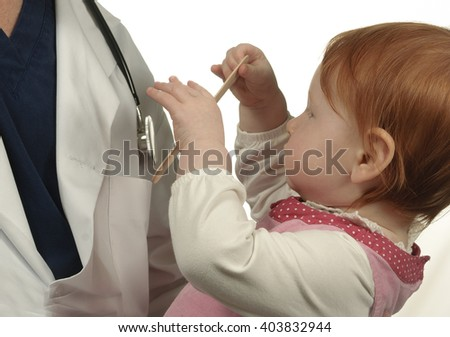 Baby gets to know her pediatrician  - stock photo