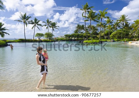 Baby girl and her girl in a lagoon on Kauai