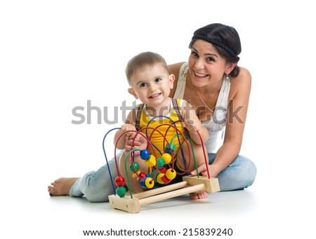 baby girl and mother play with educational toy - stock photo