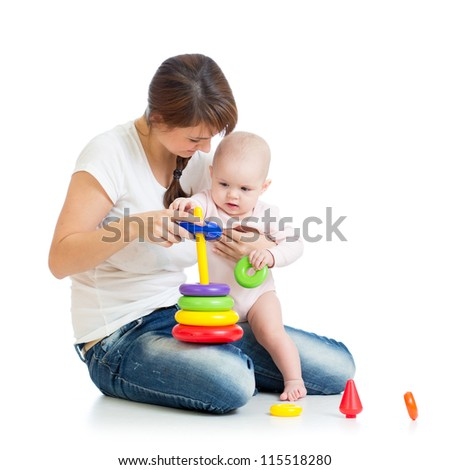 baby girl and mother playing together with construction set toy - stock photo
