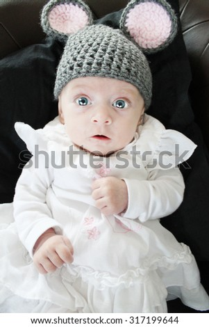 baby girl as a cute mouse wearing hand made cap - stock photo