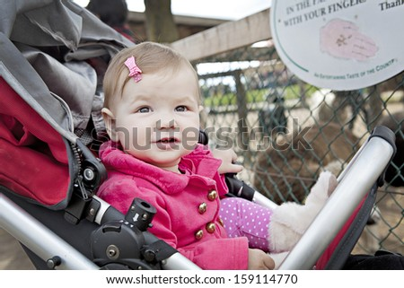 baby girl at a farm