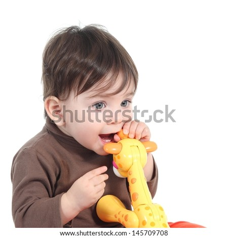 Baby girl biting an animal toy isolated on a white background - stock photo