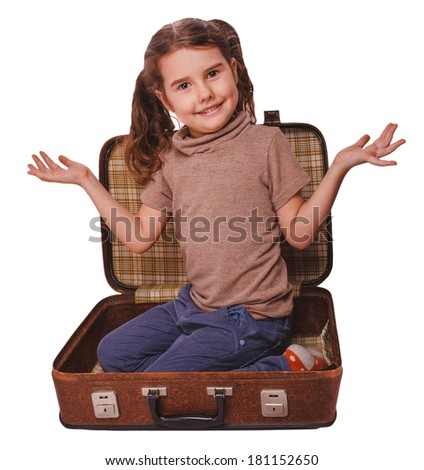 baby girl brunette sitting in a suitcase for travel isolated on white background - stock photo