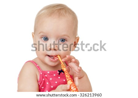 Baby girl brushes his teeth