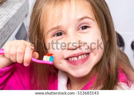 Baby Girl Brushing Her Teeth in the Morning at Bathroom Home Photo