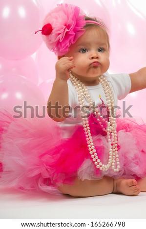 Baby girl celebrating her birthday - stock photo