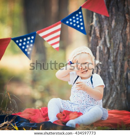 baby girl celebrating 4th july with american usa flag