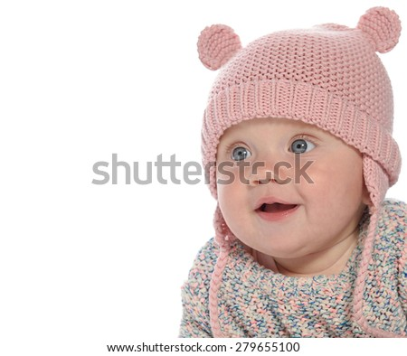 baby girl child lying down on white blanket smiling happy pink fashion portrait face studio shot isolated on white caucasian  hat warm cloting - stock photo