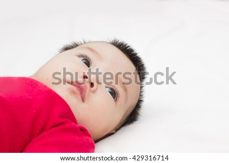 Baby girl cute wearing red dress. - stock photo