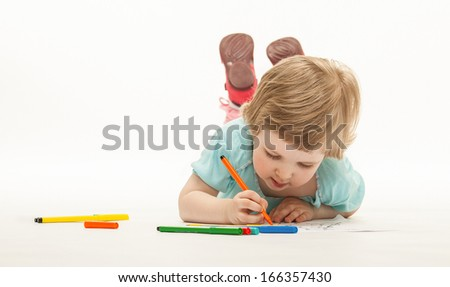 Baby girl drawing with colorful felt-tip pens on white background - stock photo